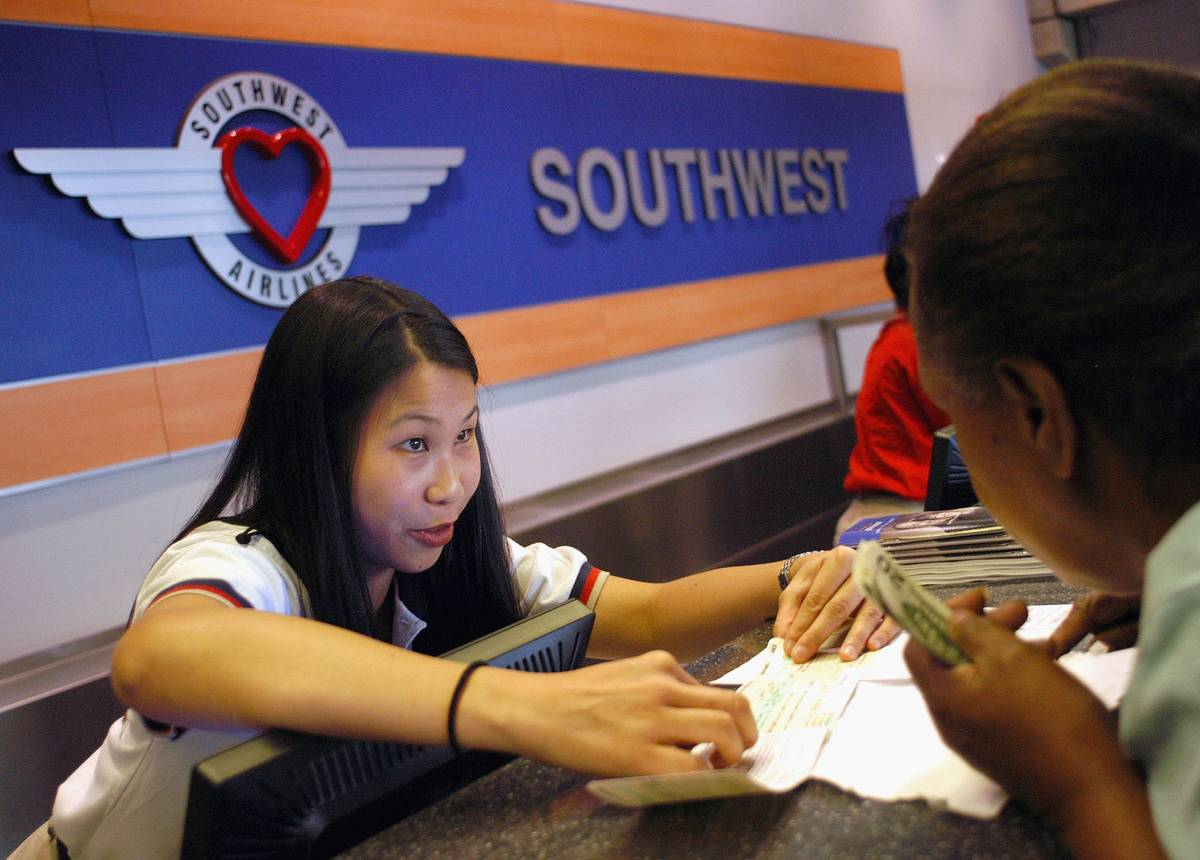 A woman sells tickets for Southwest Airlines.