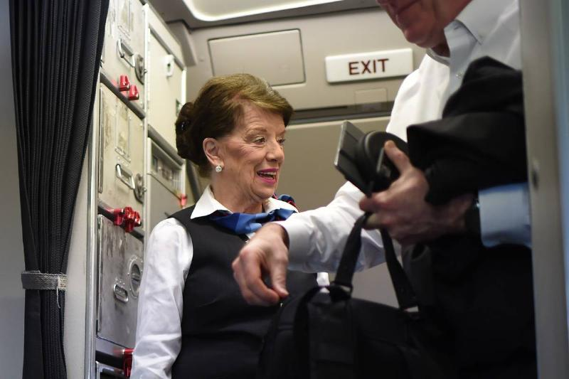 A flight attendant is 81 years old.