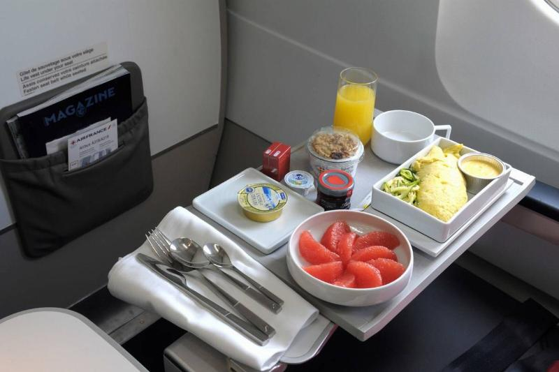 Food sits on a plane tray on a France airline.