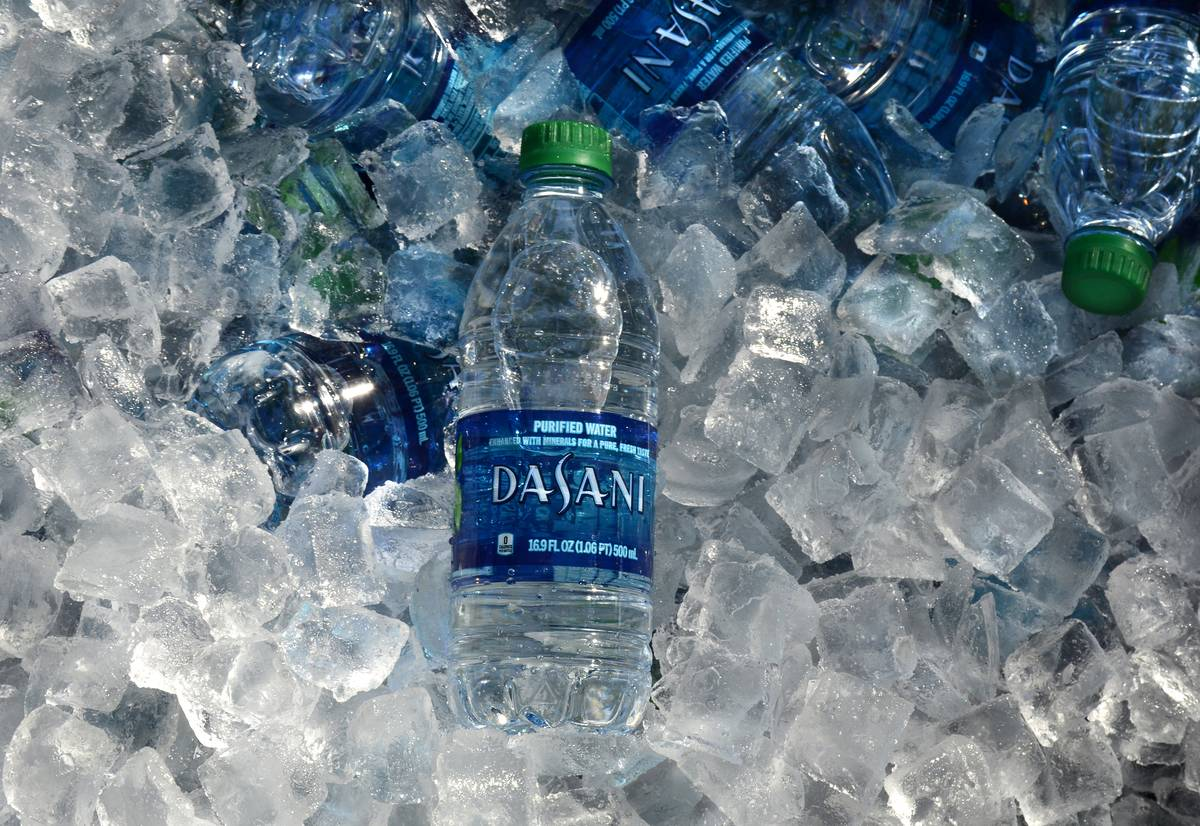 Water bottles sit on a bucket of ice.