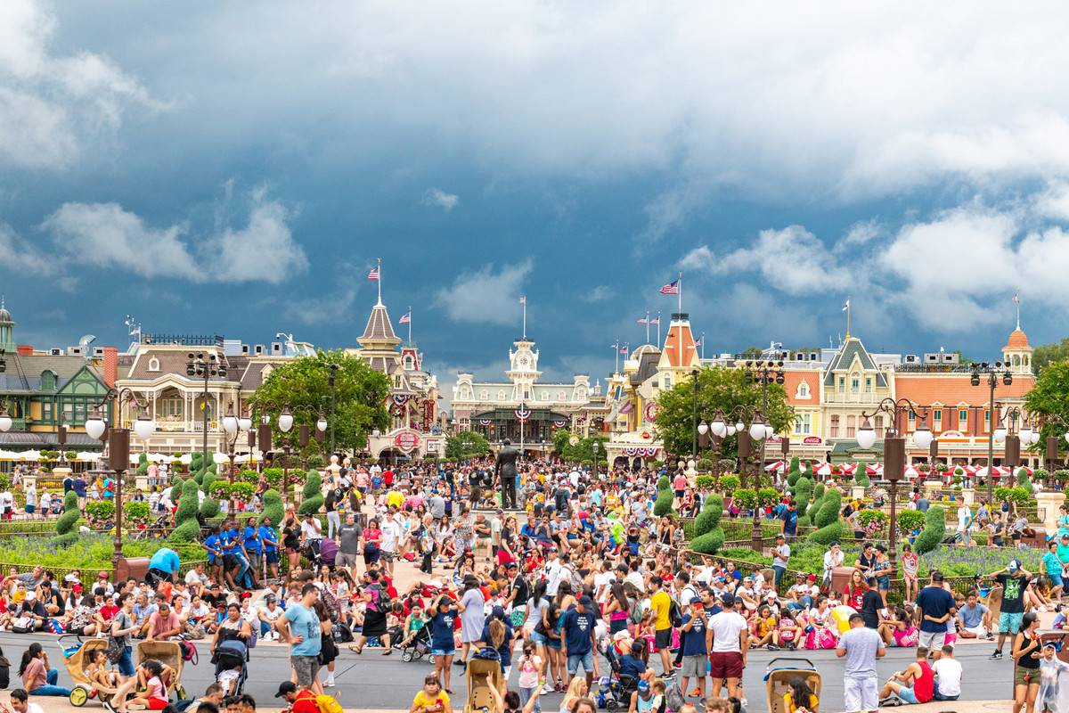 Crowds walk into the Magic Kingdom park in Disney World, FL.