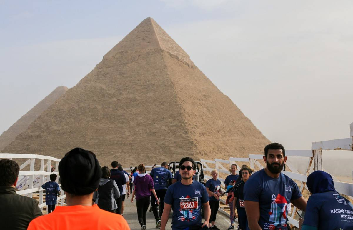 Tourists gather in front of the Great Pyramid of Giza, 2019.