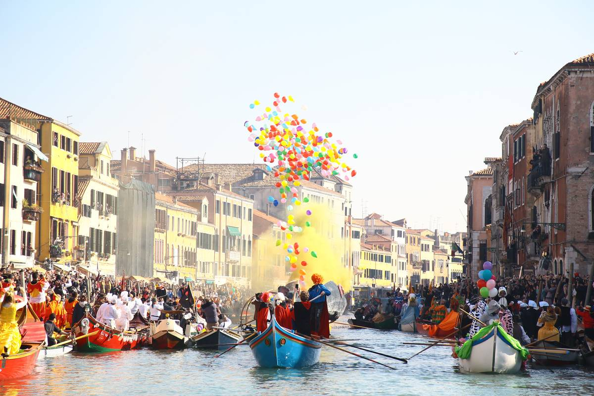 Venice Carnival celebrants release balloons while in boats on the canals.