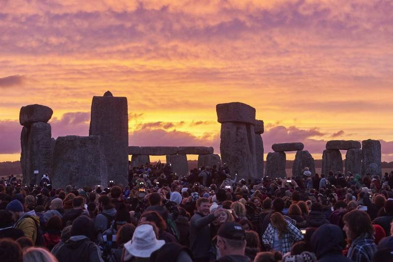 Visitors celebrate the Summer Solstice at Stonehenge, 2015.