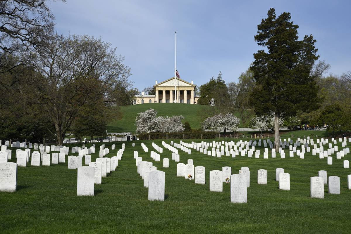 The graves of U.S. veterans and their spouses fill Arlington National Cemetery in front of the historic Arlington House.
