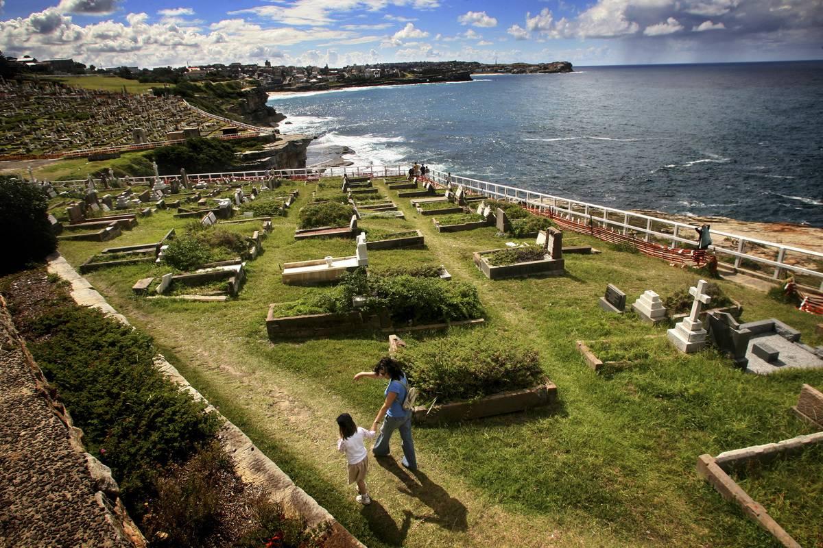People walking through Waverley Cemetery east of Sydney.