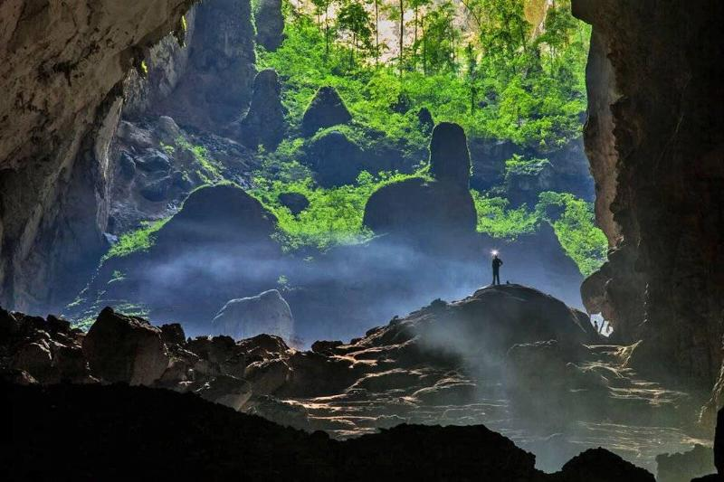 A man stands in the world's largest cave, Hang Sơn Đoòng.