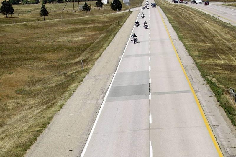 Bikers ride down I-90 in South Dakota.