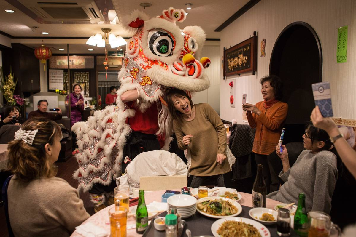 A lion dance is performed in a Japanese restaurant.