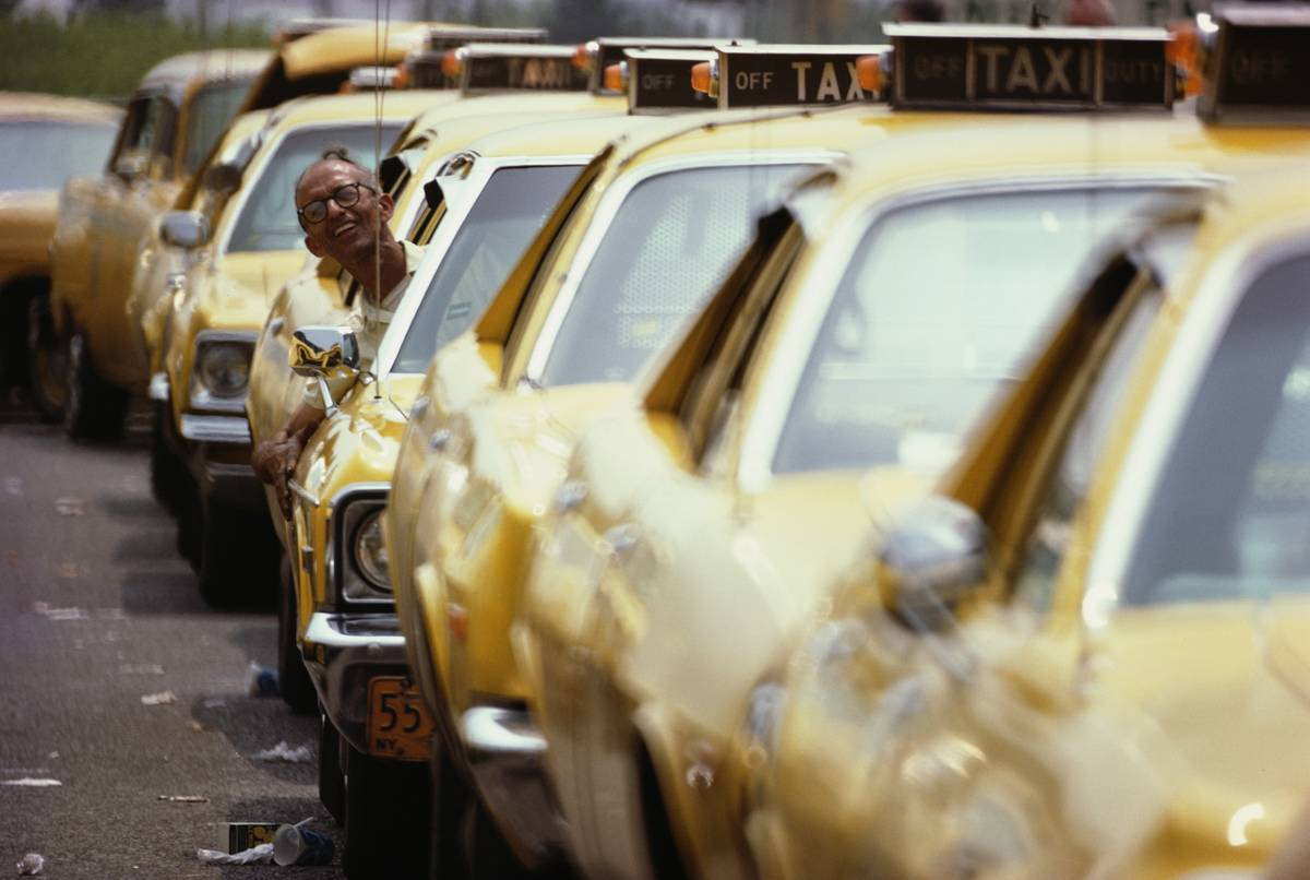 Taxis are in line waiting for passengers from the airport.