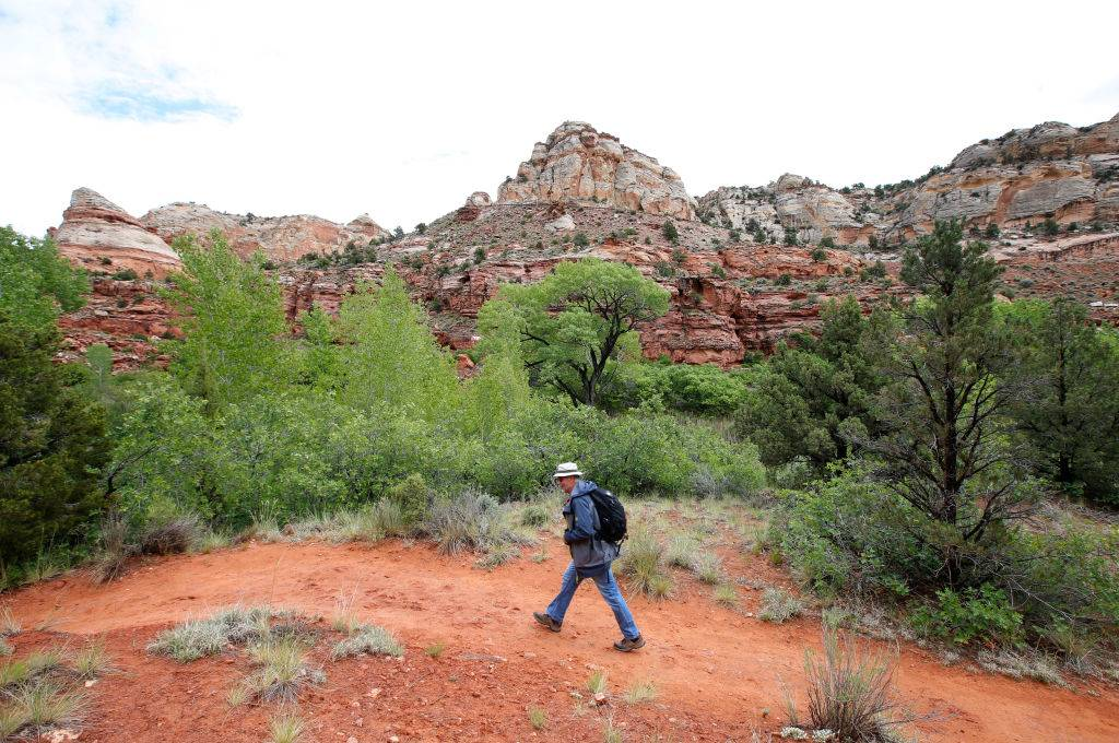 A hiker makes his way up a trail to Calf Creek in the Grand Staircase-Escalante National Monument