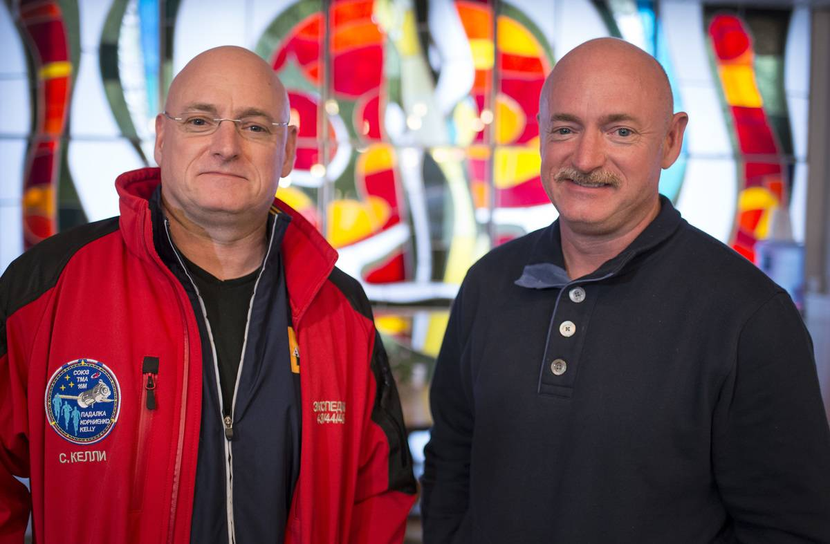Mark Kelly (right) stands next to his twin brother, Scott Kelly.