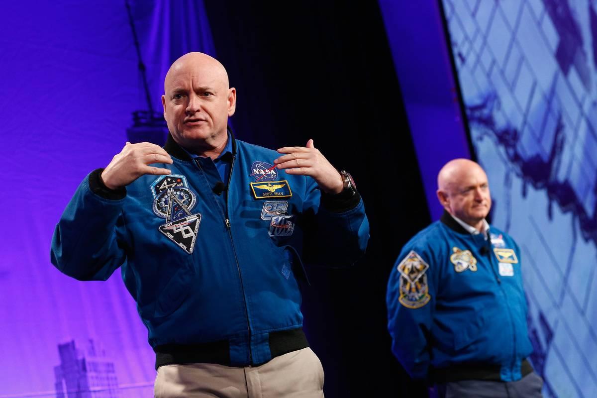 Astronauts Captain Scott Kelly and Captain Mark Kelly speak on stage at LocationWorld 2016.