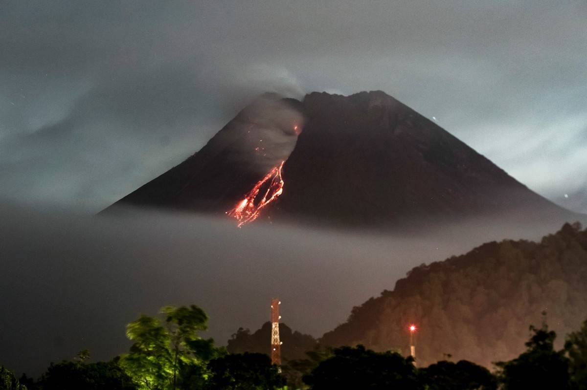 Mount Merapi erupts and pours lava near the town of Kaliurang, Indonesia.