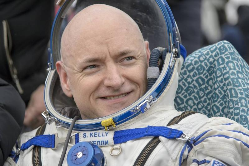 Captain Scott Kelly sits in his space suit outside the Soyuz TMA-18M spacecraft.