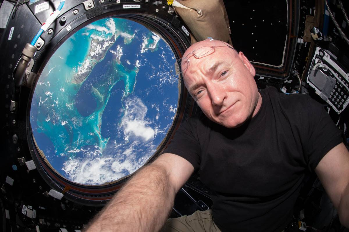 Scott takes a photo of him in the International Space Station.