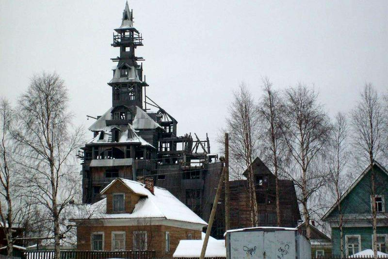 The Sutyagin House, the world's tallest wooden house, is 14 stories tall and covered in snow.