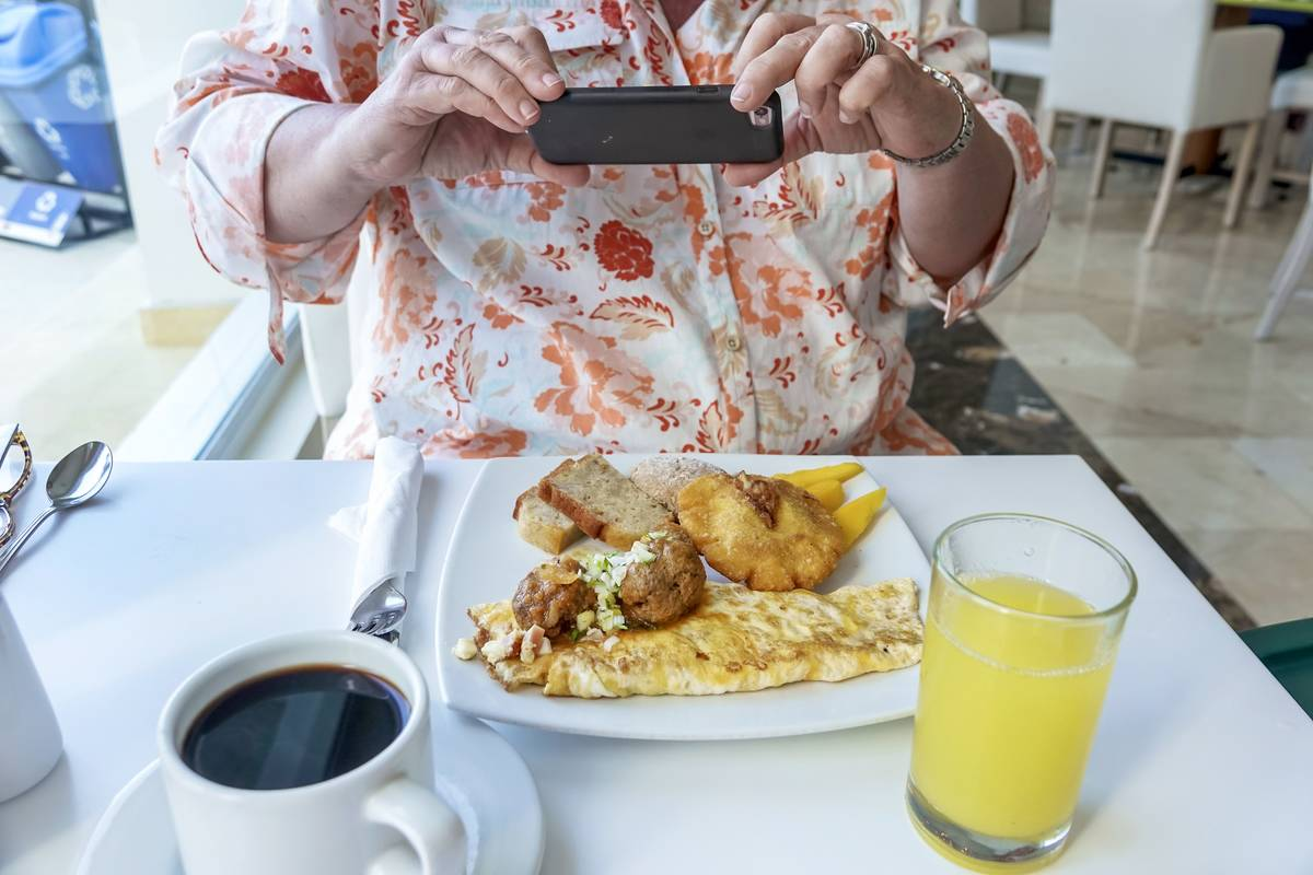 Hotel Dann Cartagena, woman photographing buffet breakfast
