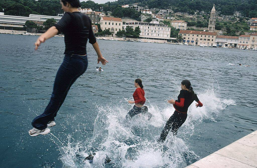 people jumping into the water in Hvar, Croatia