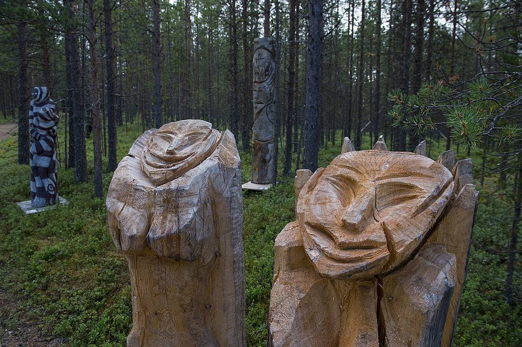 Wooden sculptures displayed outdoors at the Siida Museum in Lapland, Finland