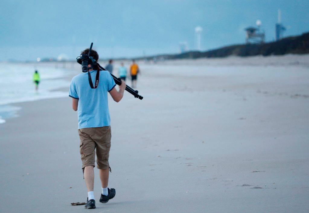 A visitor arrives at sunrise at Playalinda Beach