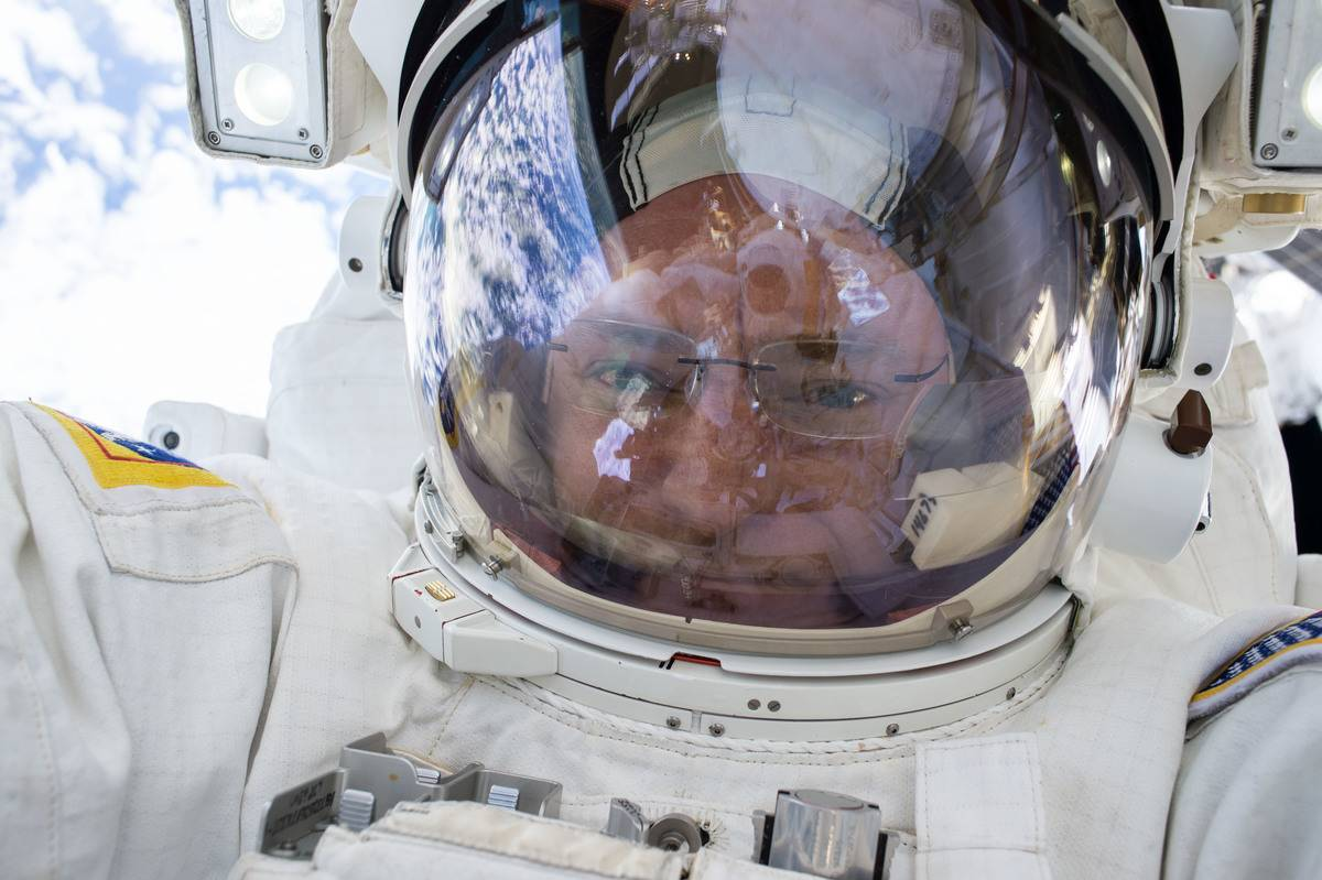 Scott Kelly takes a picture in his space suit before liftoff.