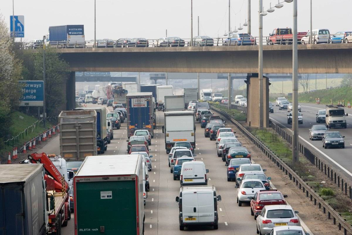 Traffic clogs the freeways of the UK during rush hour.