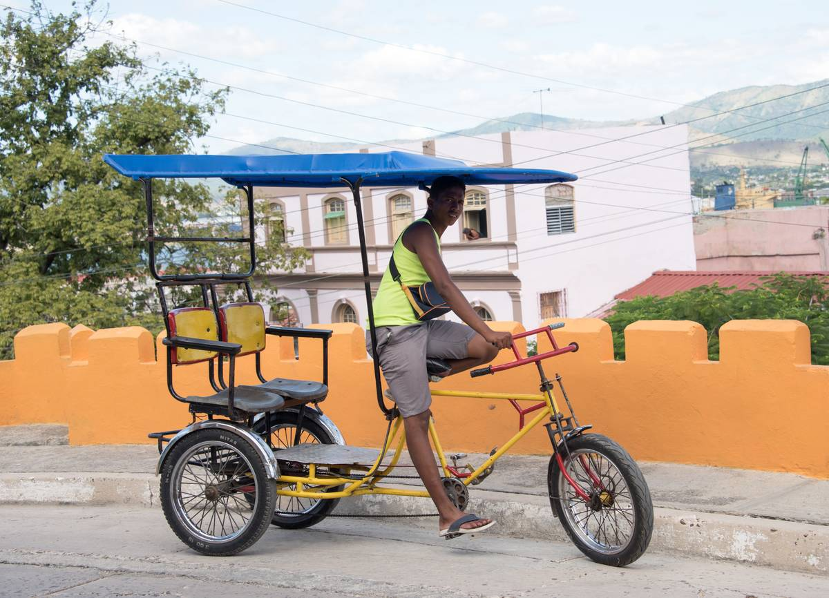 Cuban real people lifestyle: Man sitting on tricycle or '...