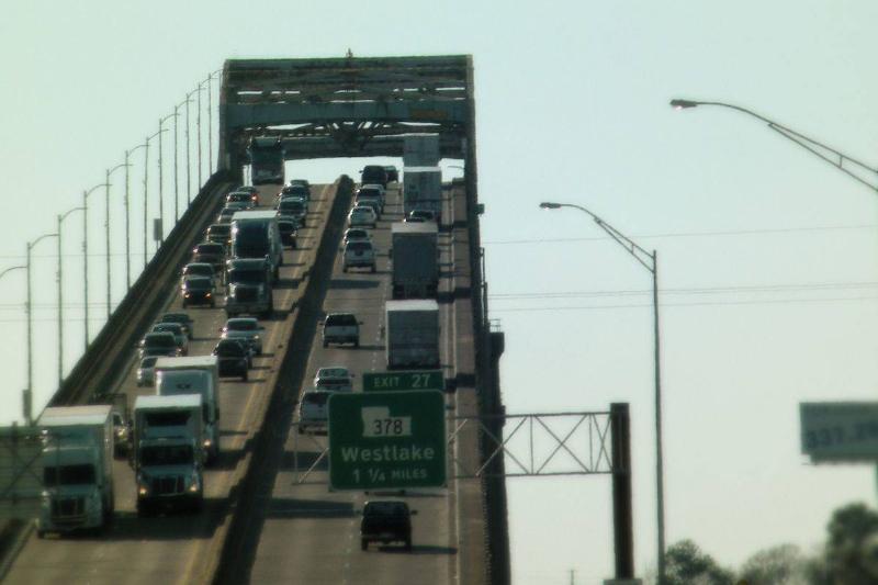 Cars drive up the Calcasieu River Bridge in Louisiana.