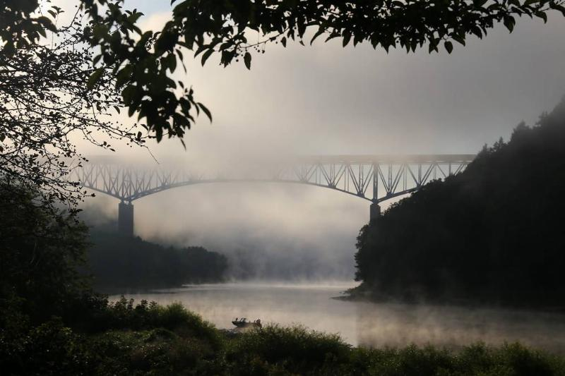 Emlenton Bridge in Pennsylvania is covered in fog.