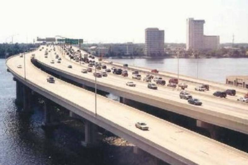 Cars travel up and down the Fuller Warren Bridge in Jacksonville, FL.