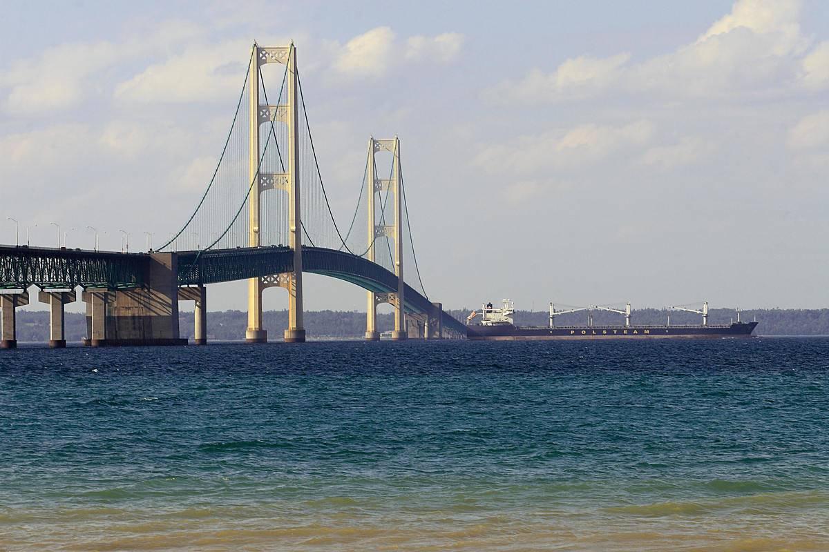A ship passes beneath the Mackinac Bridge in Michigan.