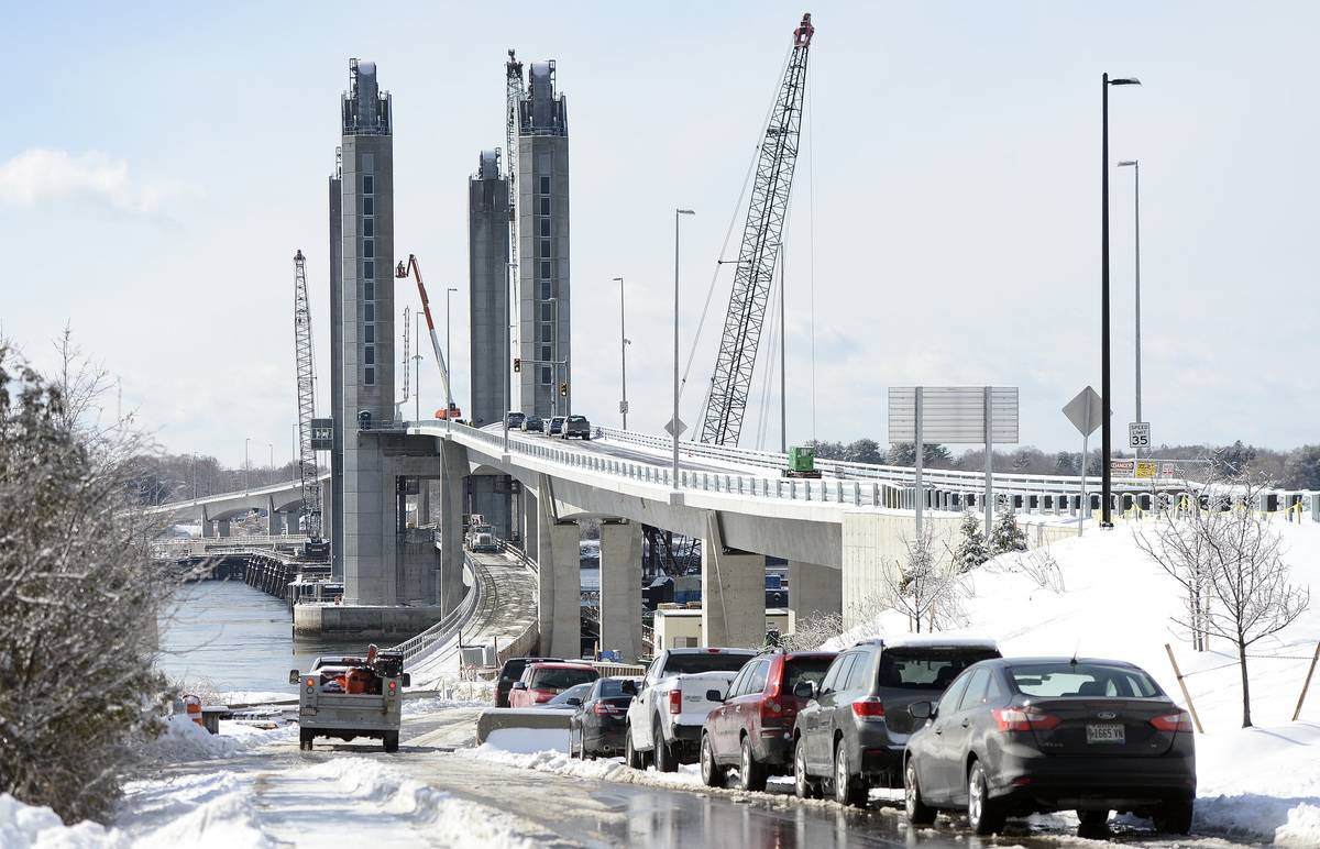 Cars drive across the Sarah Mildred Long Bridge in Maine in the snow.