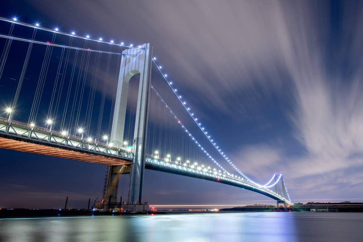 New York's Verrazzano-Narrows Bridge is lit up at night.