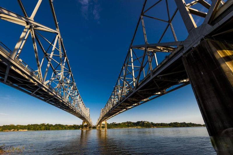 Vicksburg Bridge, which crosses the Mississippi River, is seen from the ground.