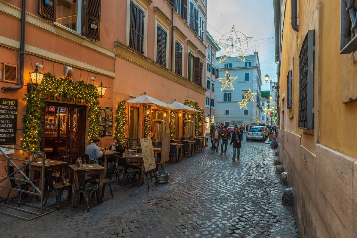 Trastevere district decorated with Christmas lights, Rome, Lazio, Europe.