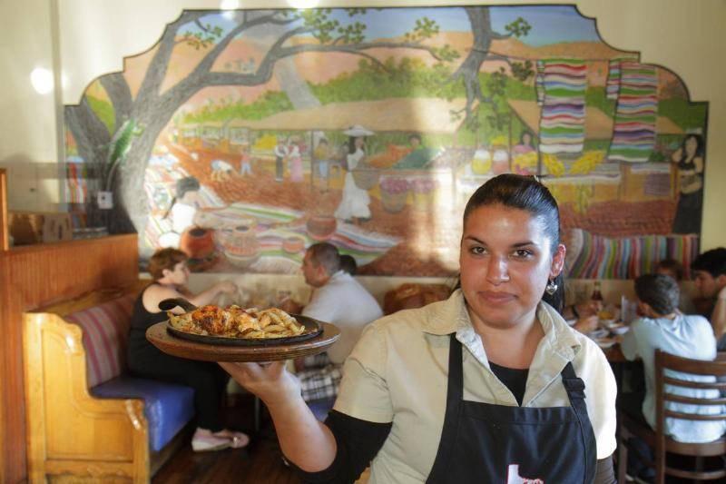a-waitress-serving-food-at-casita-tejas-mexican-restaurant.-31628
