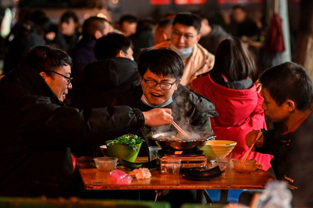 people eating at a restaurant in China