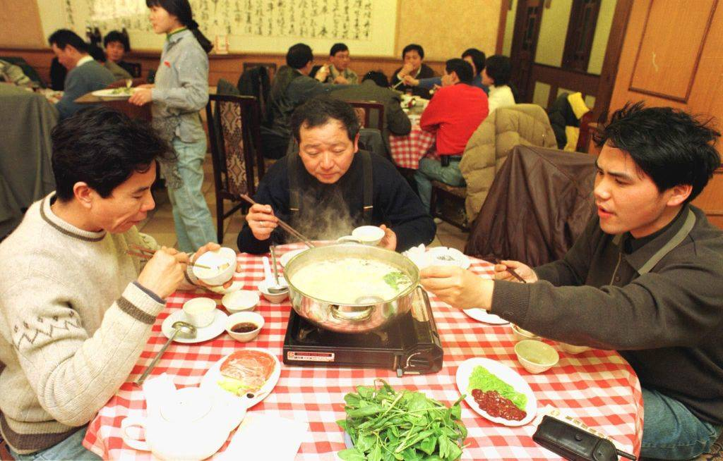 people eating at a table in China