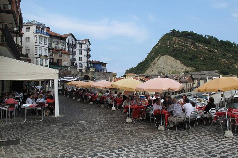 people eating outside in Spain
