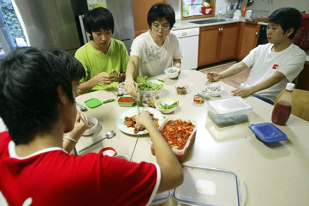 boys eating food in south korea