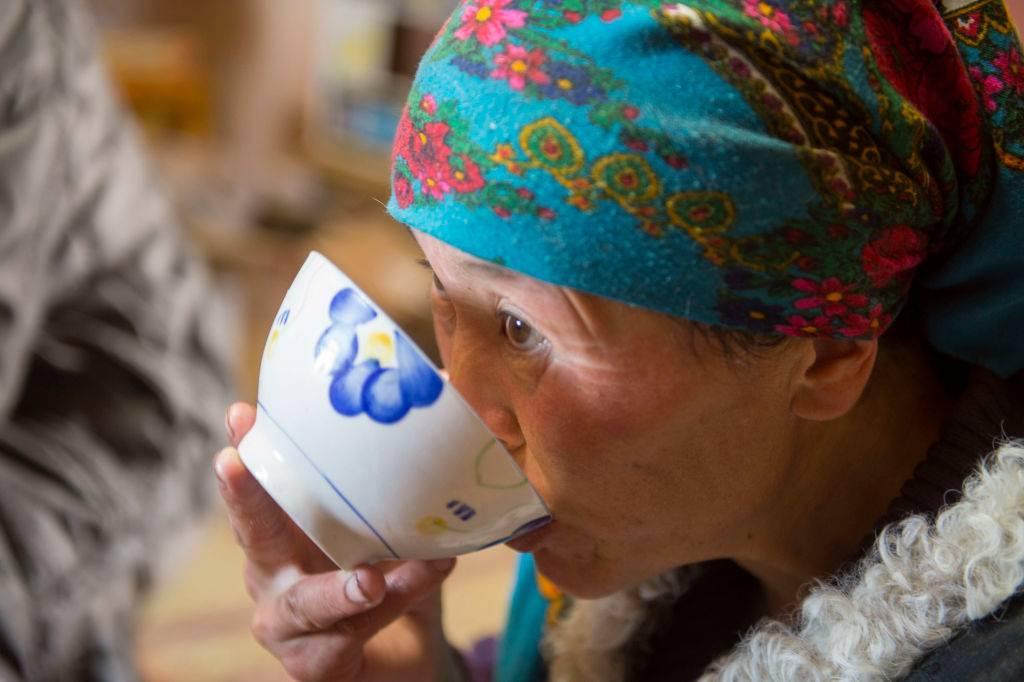 Close-up of a Kazakh woman drinking traditional suutei tsai